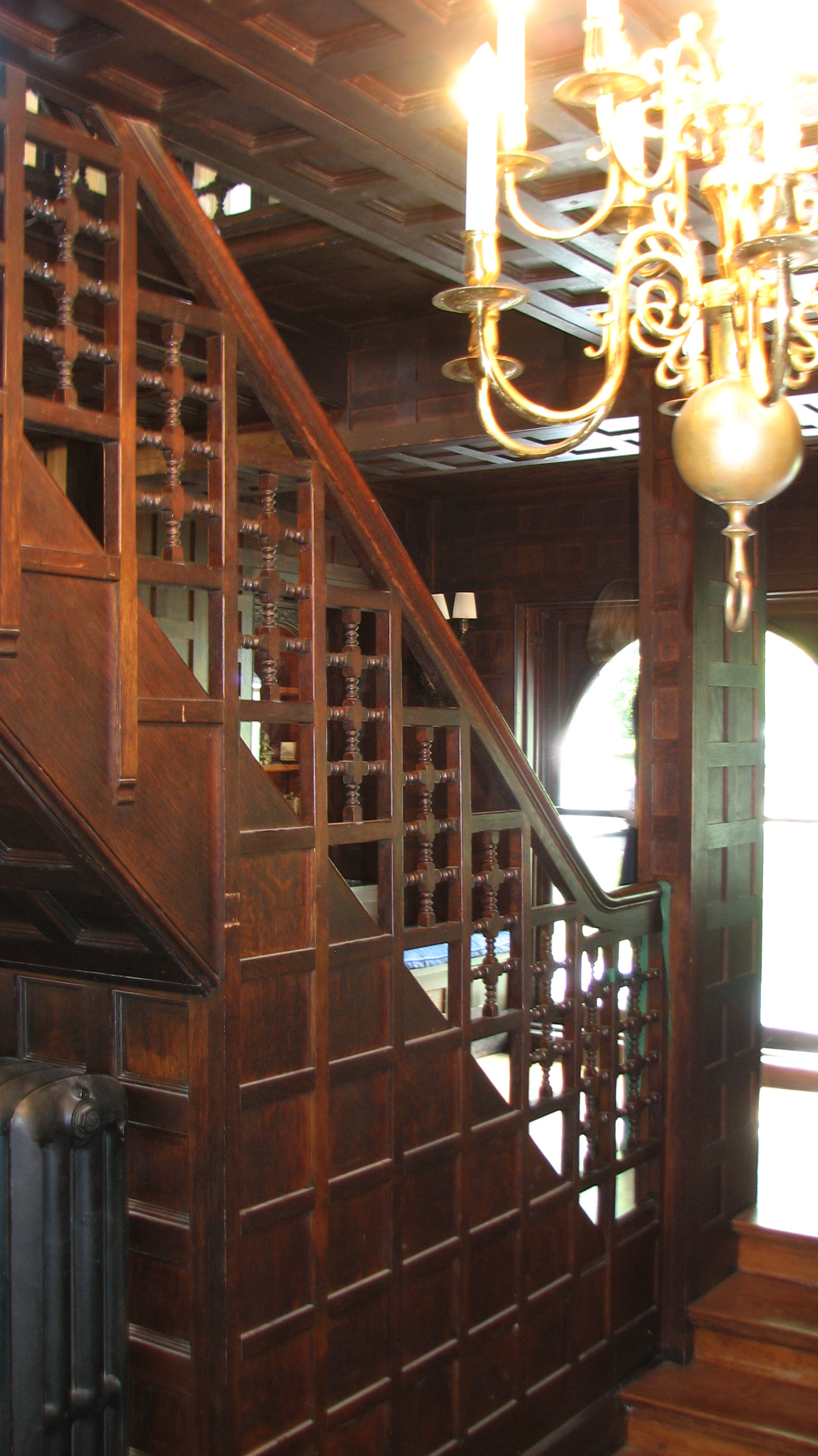 Interior details include a grand staircase and carved wood paneling