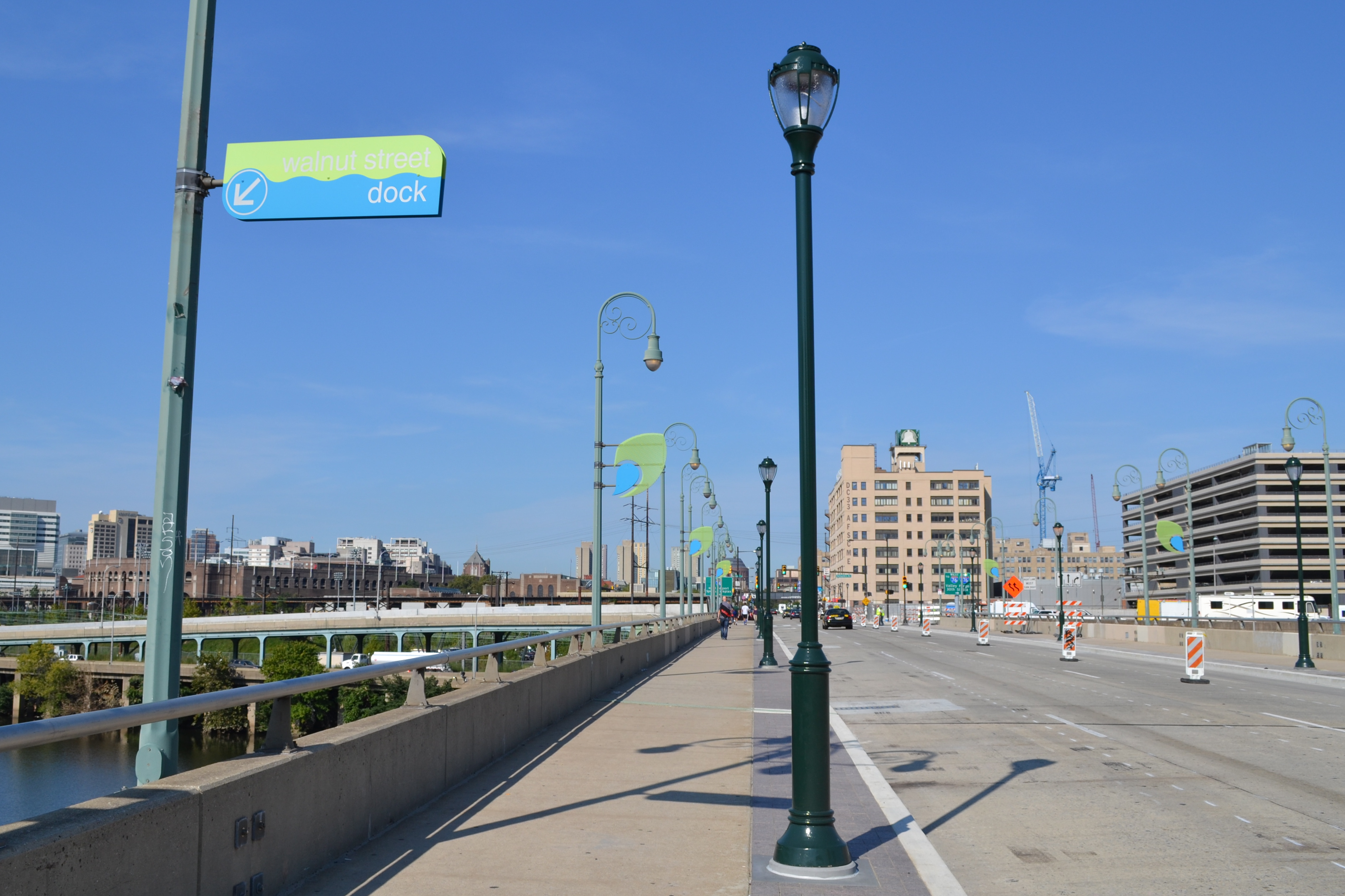 The new Walnut Street Bridge design includes widened sidewalks and pedestrian-scale lighting