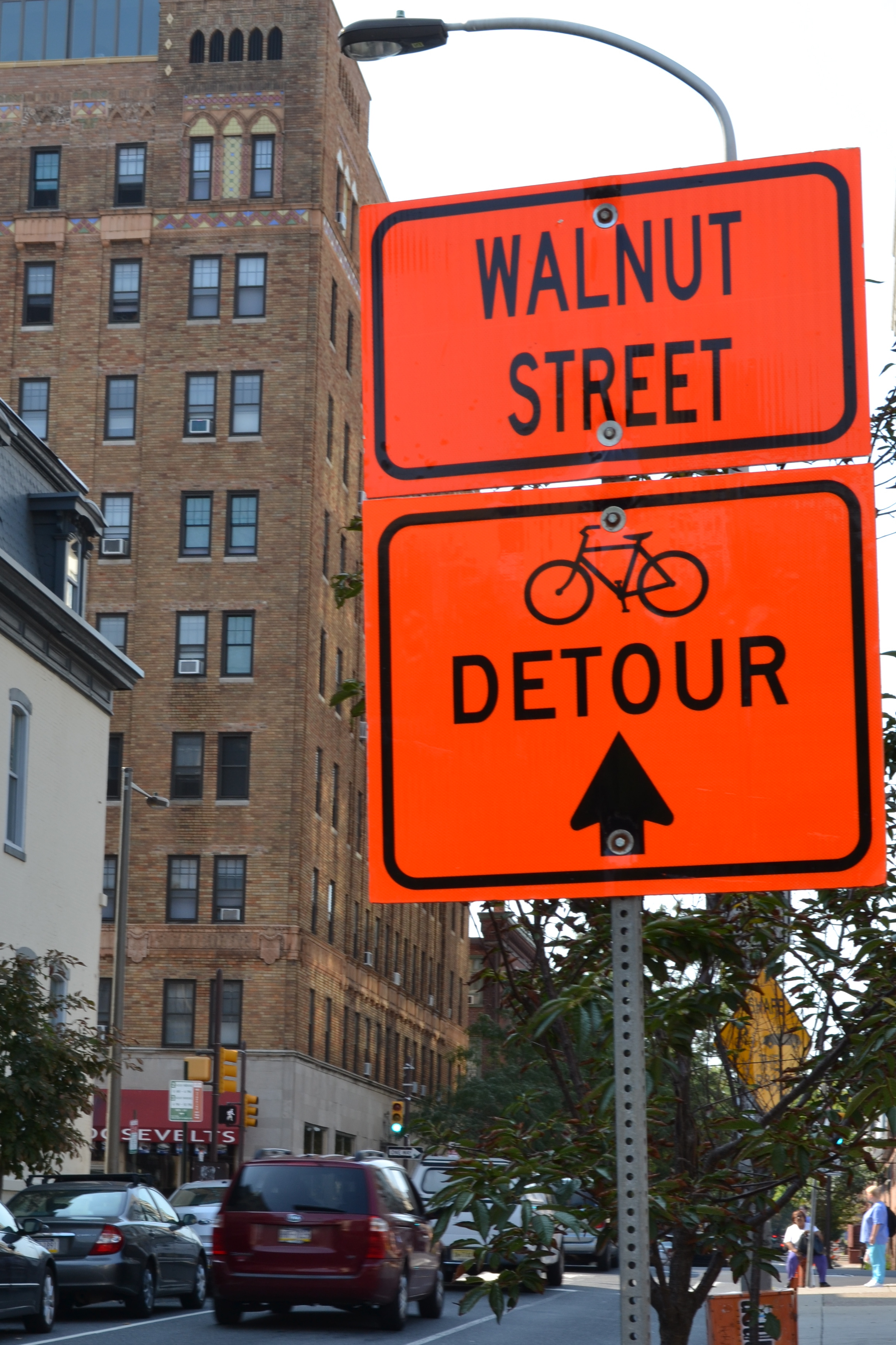 During construction detour signs directed bicyclists across the South Street Bridge