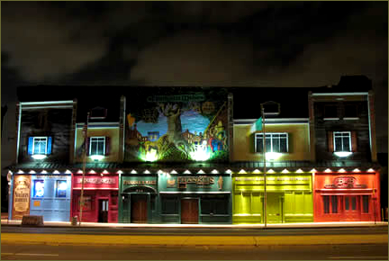 An evening shot of the colorful front of Finnegan's Wake, from the website