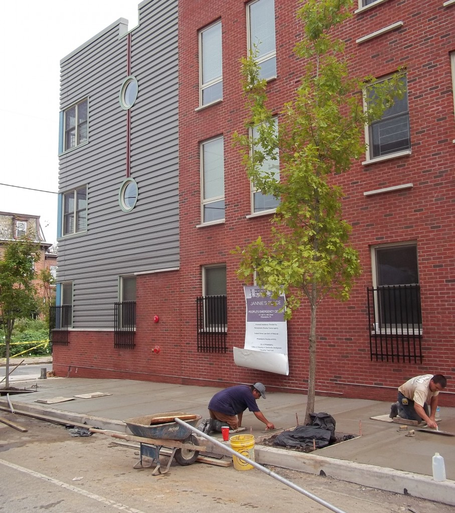 Laying the concrete in front of Jannie's Place. | Kara Savidge for Philadelphia Neighborhoods