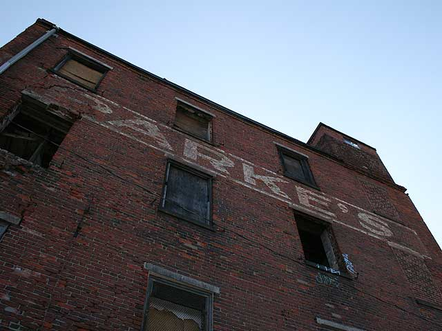 The warehouse at Front and Girard had many lives before being destroyed by fire Tuesday. via Ghost Sign Project c. 2006