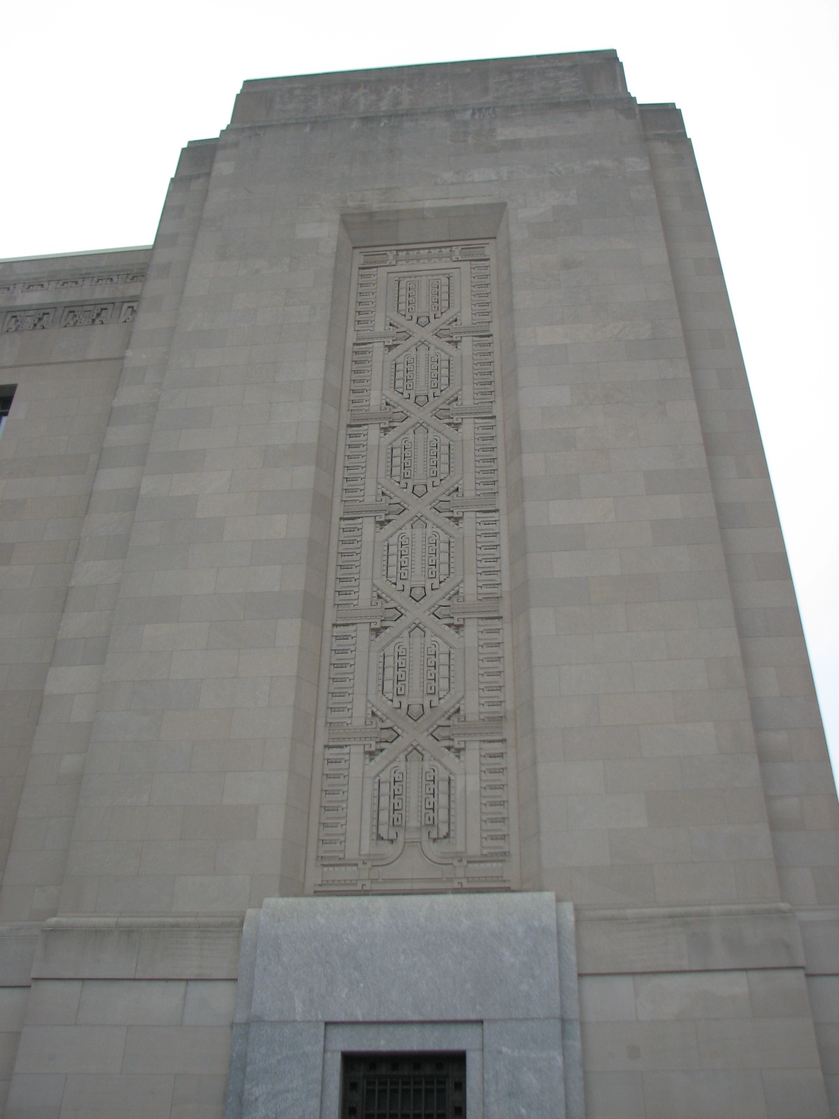 The pylons of the building are adorned with elaborate patterns.