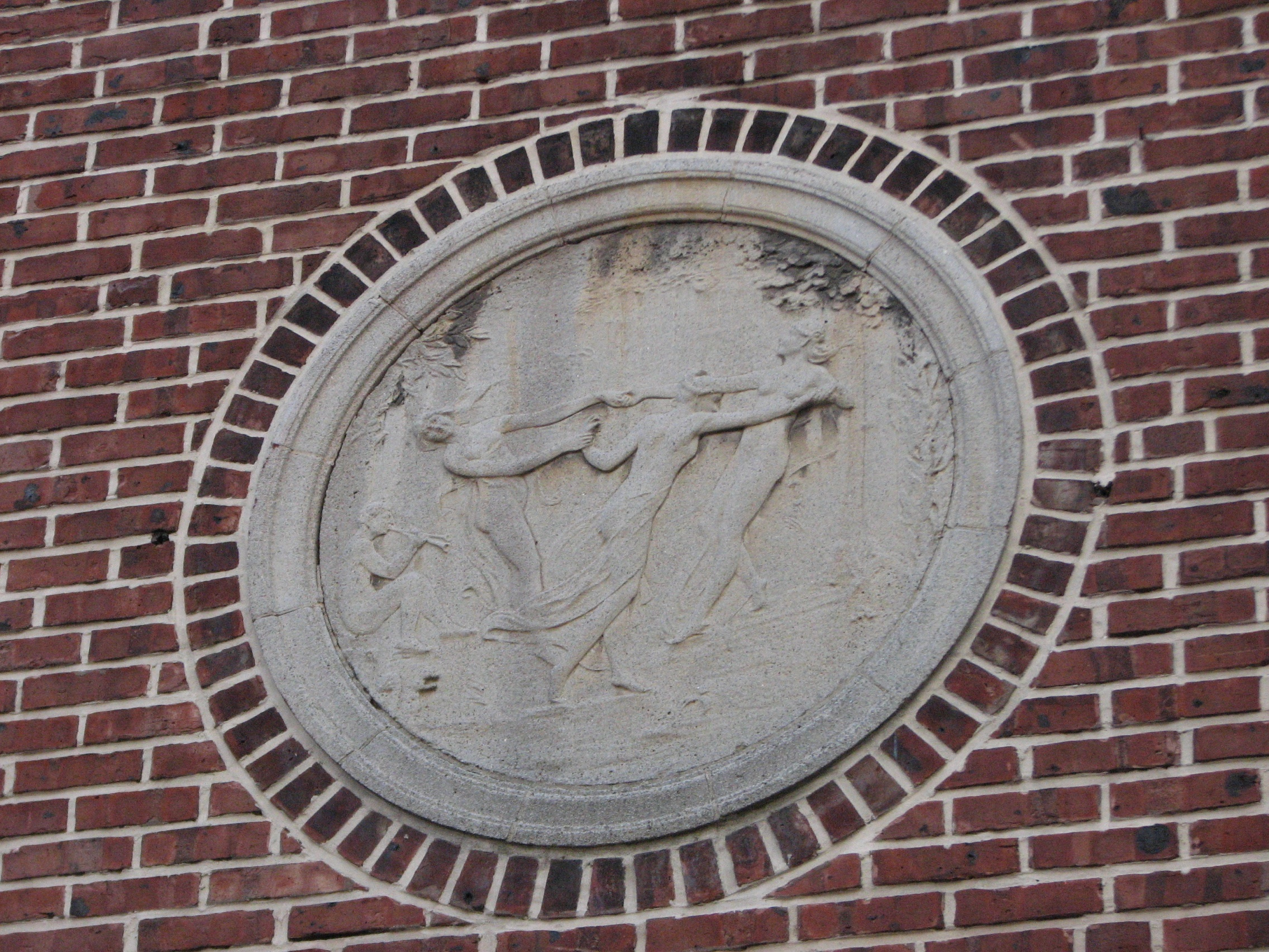 The original design included theatrical bas reliefs on the front of the building.