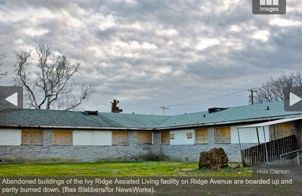 Abandoned buildings of the Ivy Ridge Assisted Living facility on Ridge Avenue are boarded up, partly burned. (Bas Slabbers)
