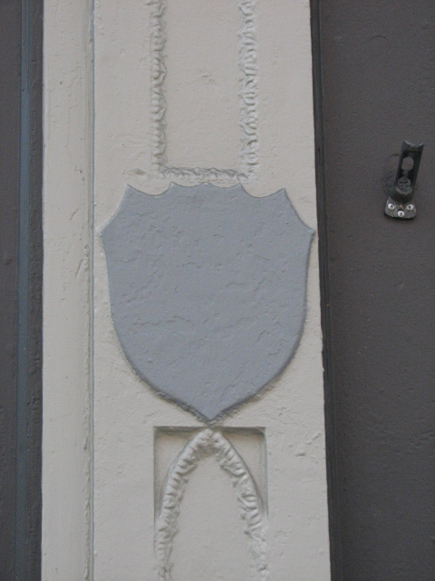 Shields that probably bore the St. Charles name are still found on the first-floor columns.
