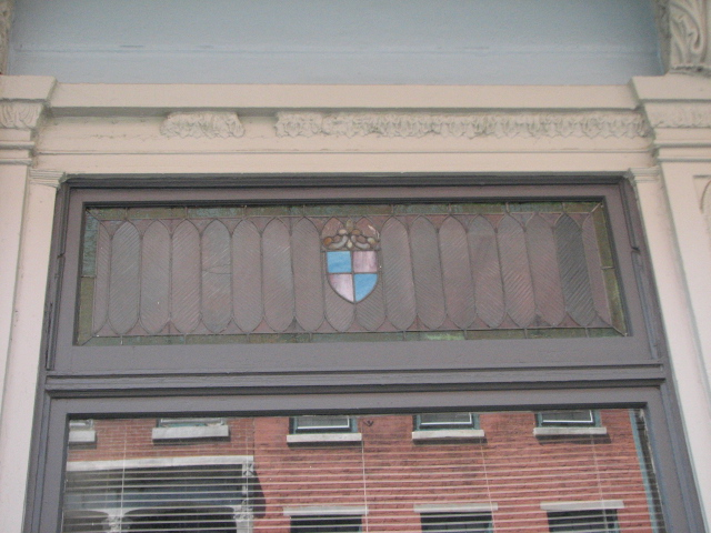 A few of the stained glass panels have survived the building's transitions.