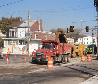 Workers regrade State Road at Princeton Avenue in Tacony. PennDOT photo