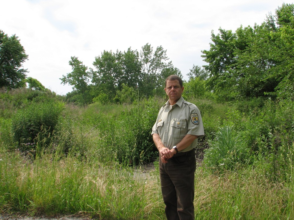 Heinz Refuge Manager Gary Stoltz standing on the end of Lindbergh Boulevard