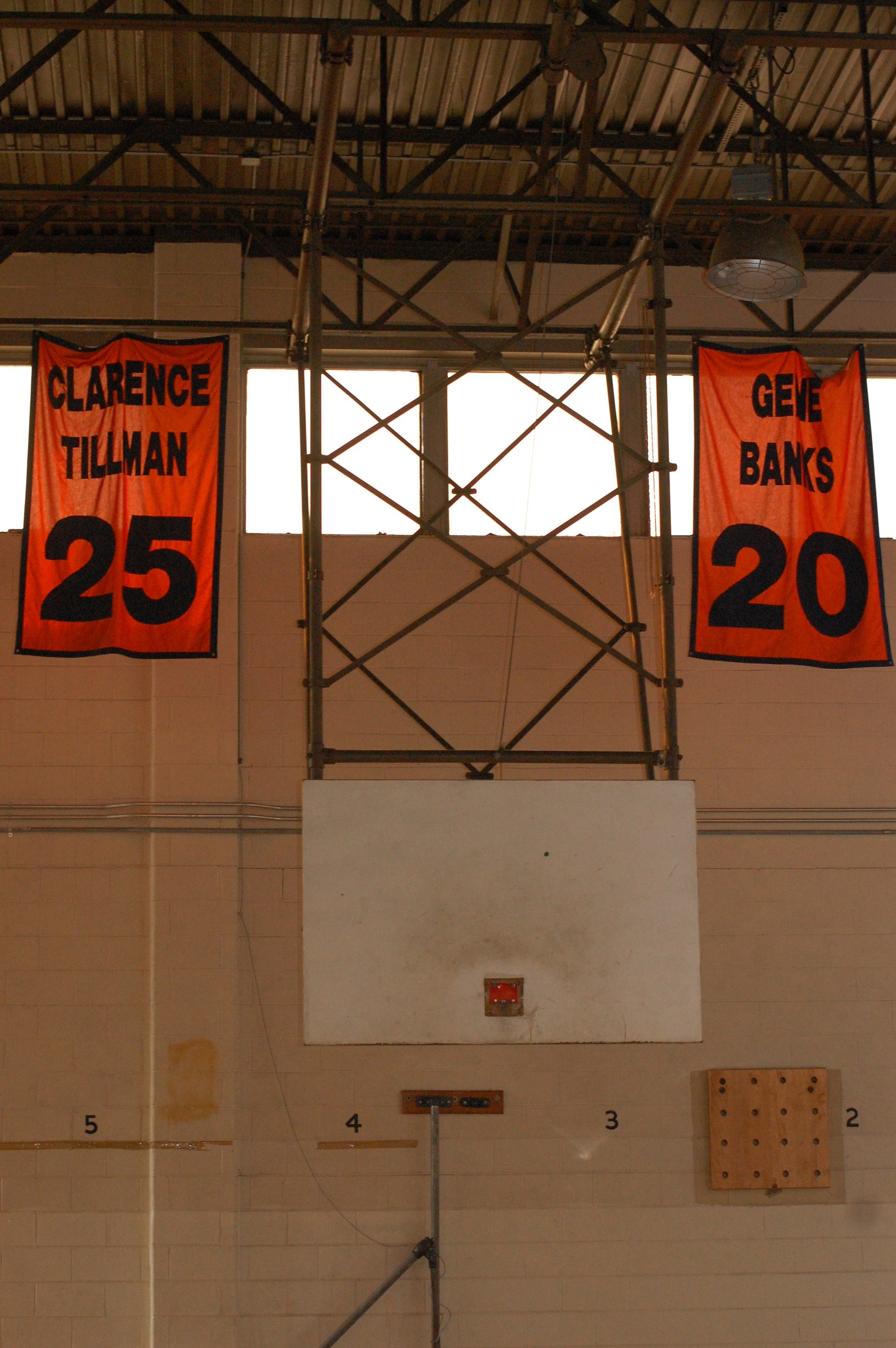 Banners honoring W. Philly legends of the past hang above a broken backboard.
