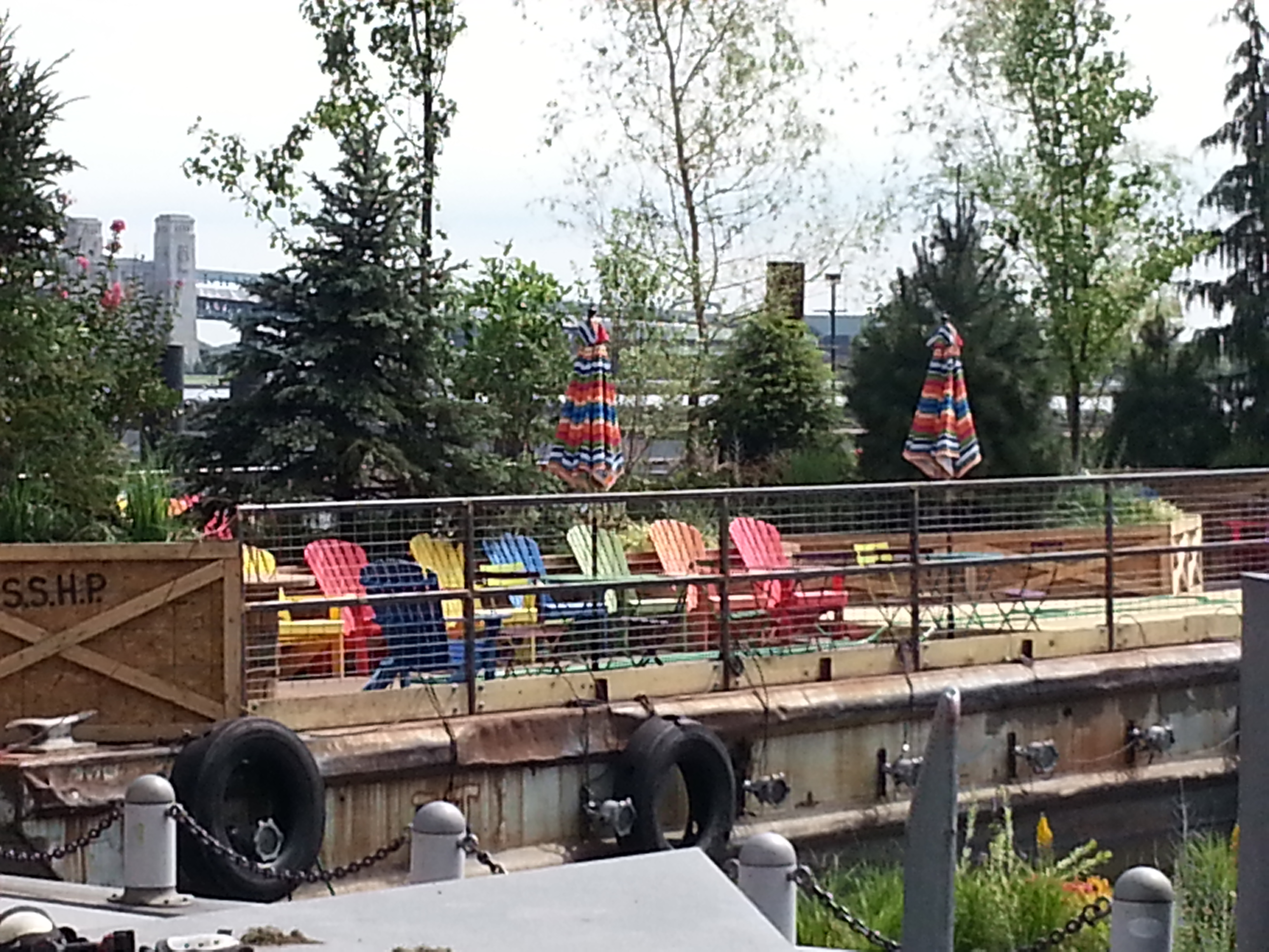 Colorful chairs lined up on one of the three Spruce Street Harbor Park barges