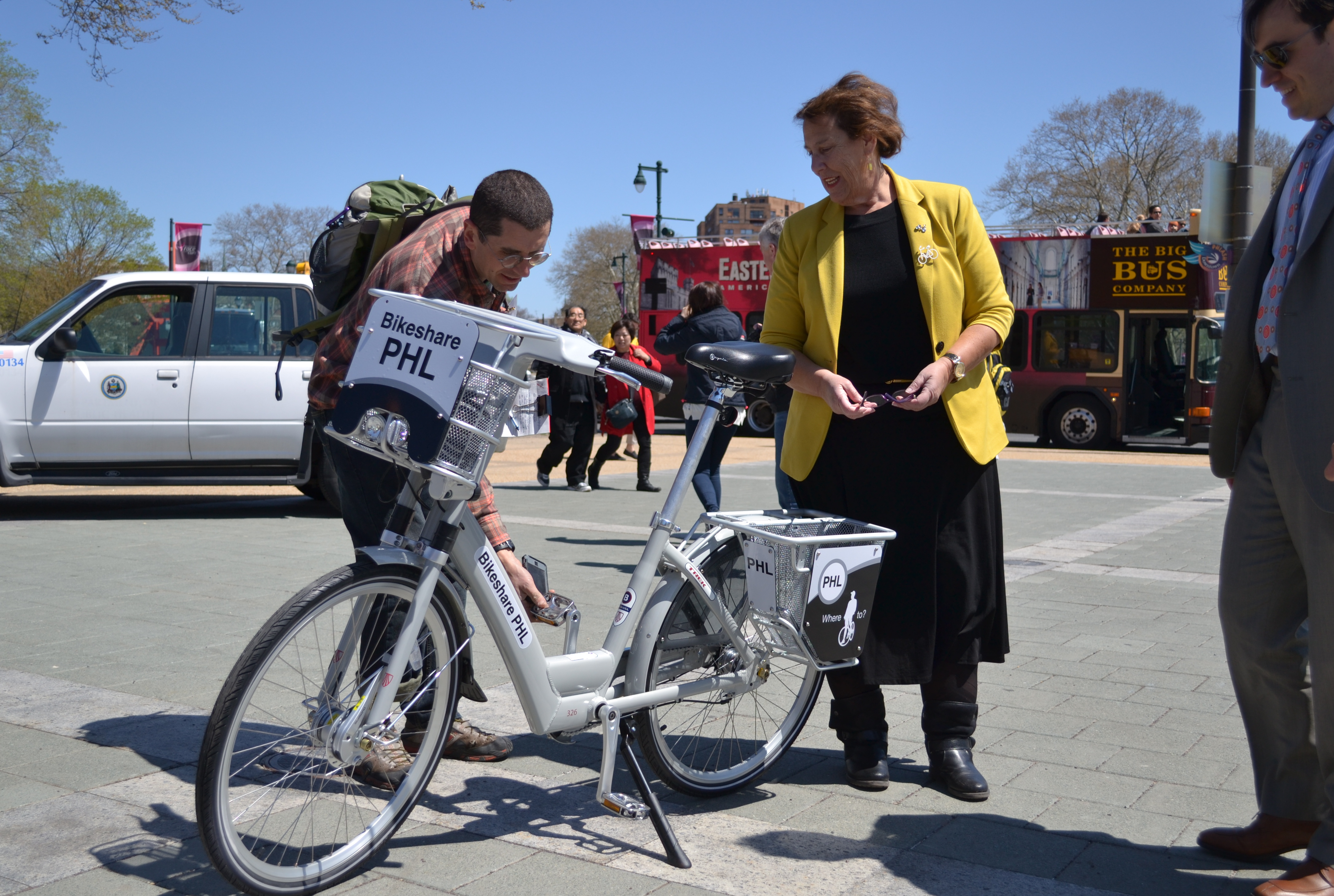 Cutler stands with the model bike-share bike