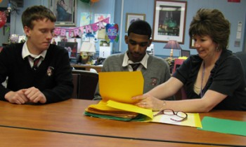 Ryan Director of Admissions Pam McPeak discusses the school's shadow program with students, junior Christopher Gatton (left) and freshman Julio Polanco (center).