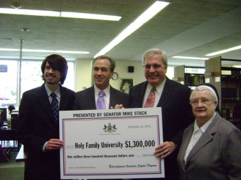 Sen. Stack (second from left) presents a $1.3 million grant to Holy Family University. With him are (L to R) Holy Family student Matthew Reese, Associate Professor of Political Science Dr. Stephen Med