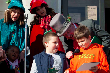 Kids join in on Christmas carol singing at Saturday's Winterfest in Tacony. Photo by Liza Meiris.