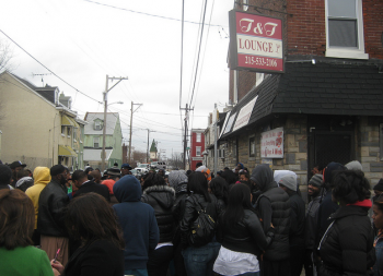 Family, friends and neighbors gathered outside the former T&T bar last winter after 20-year-old Chris Spence was fatally shot following a scuffle inside the establishment. Photo/Shannon McDonald