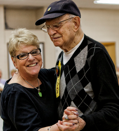 Klein JCC Program Director for Adult Services Shelley Geltzer enjoys a slow dance with Dr. Fred Goldman on his 100th birthday. Photo/Michelle Alton