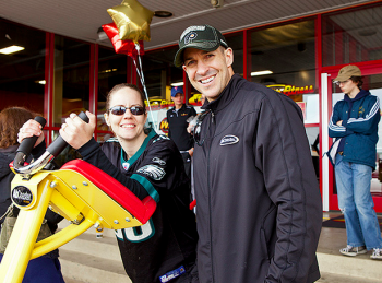 ABCOASTER competition winner Angela Radesky and RetroFitness staff member Michael Ritter at the gym's gran reopening Saturday, April 28. Photo/Michelle Alton