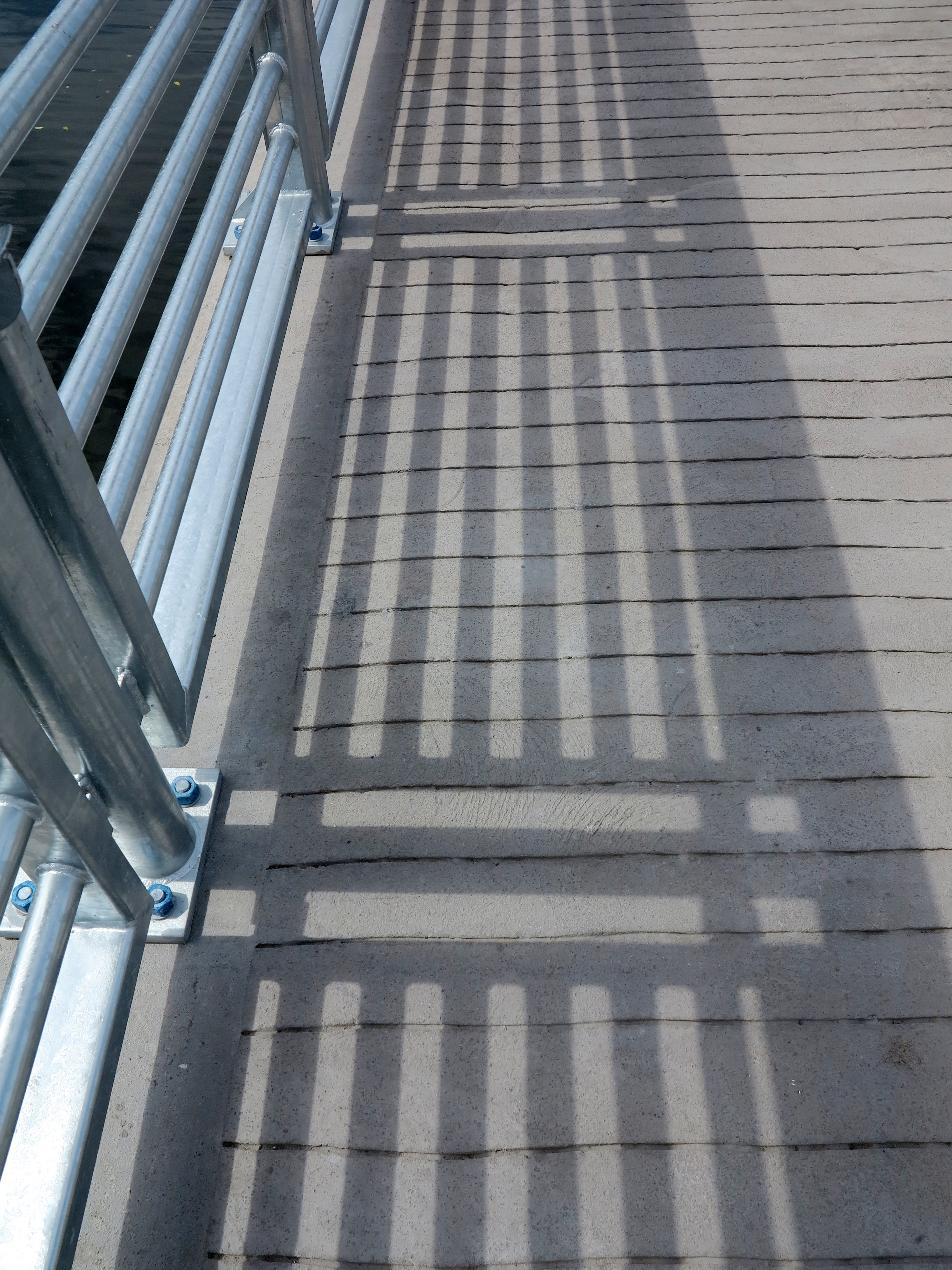 Boardwalk textures: Scored concrete, stainless stell railings