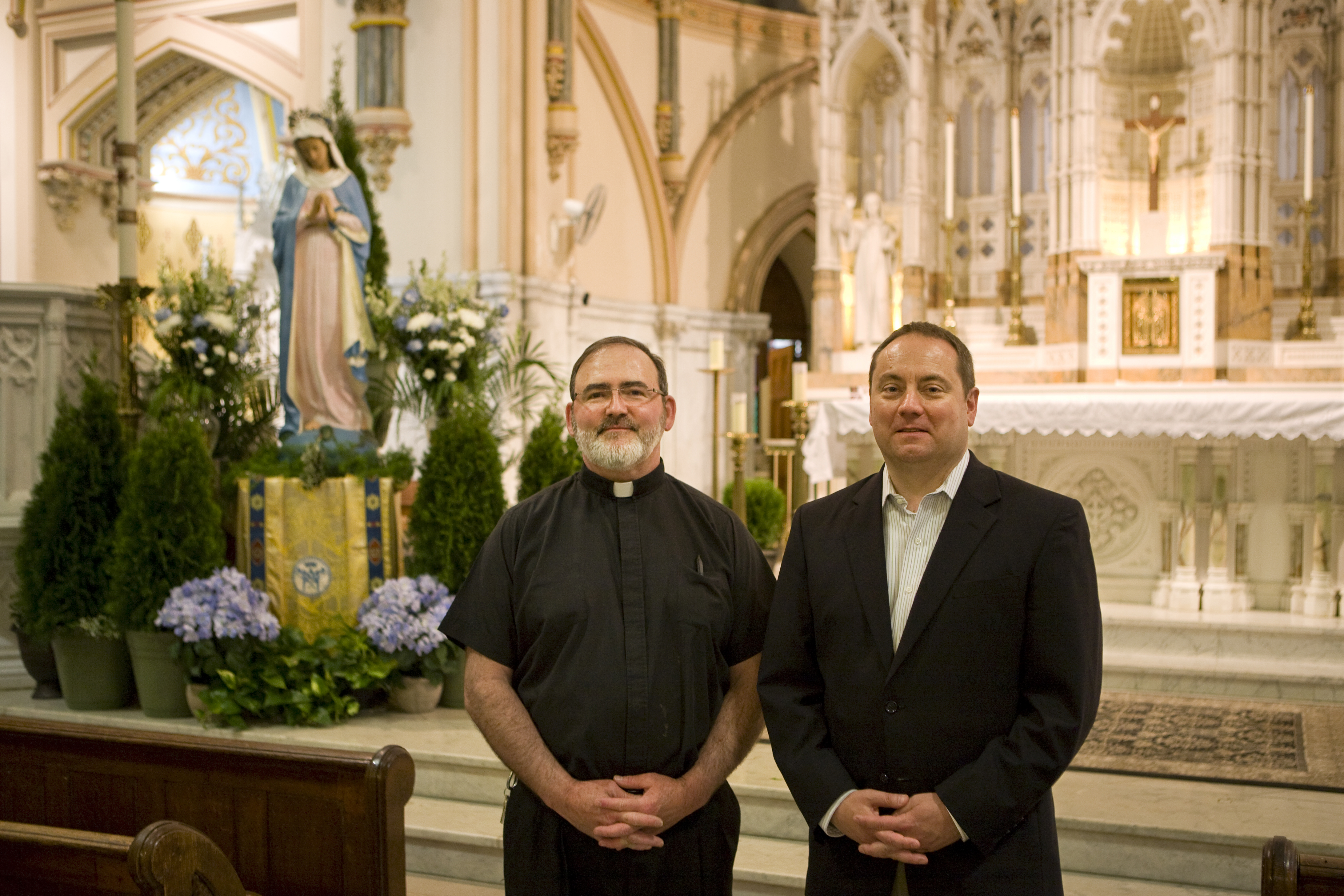 Father Kevin Lawrence (left) and Rich Van Fossen in the sanctuary of Saint John the Baptist, 2015 | Credit: Bradley Maule
