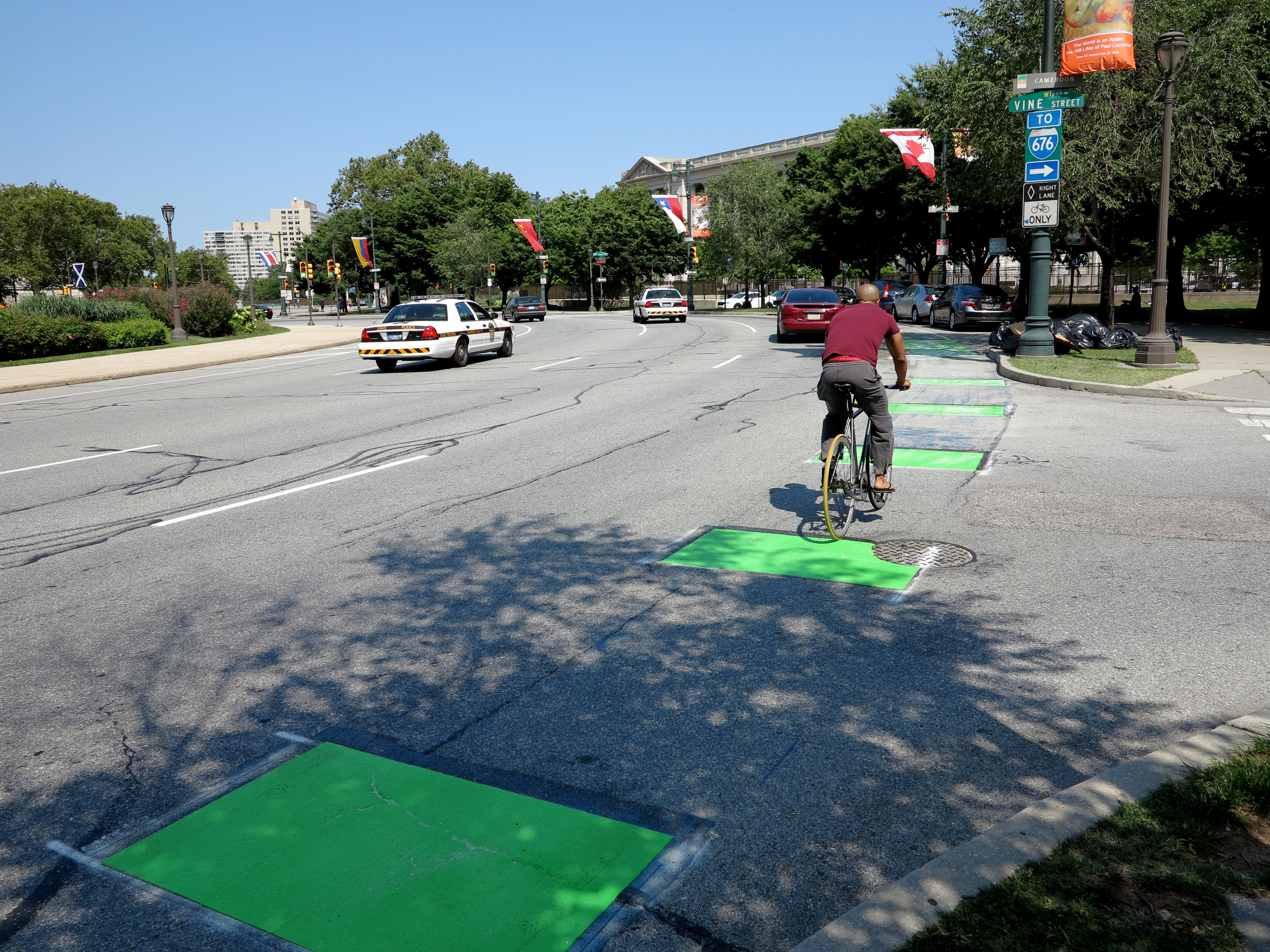 Fresh green paint for a bike/car conflict zone on Logan Circle