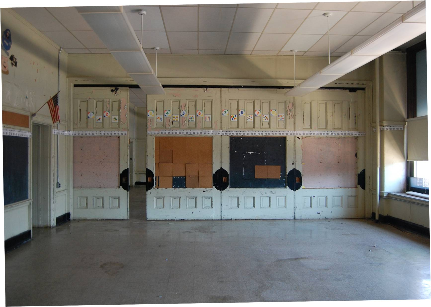 Old Frances Willard School still has classic millwork like these sliding partitions | courtesy of Community Design Collaborative