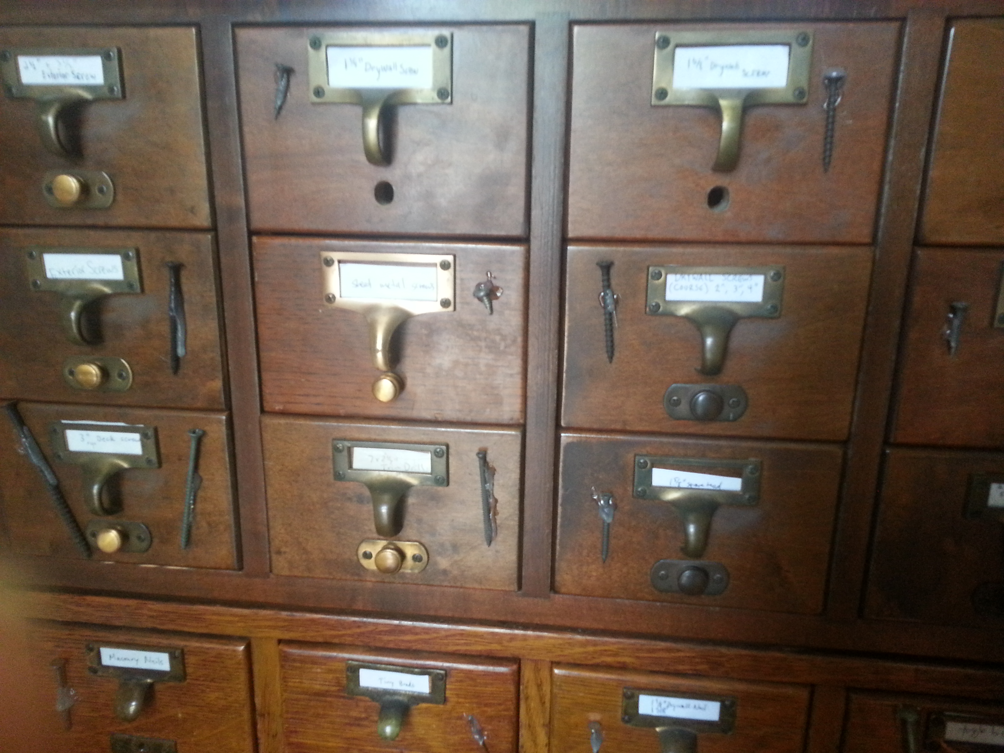 Old medical library card catalogue holds tool library screws