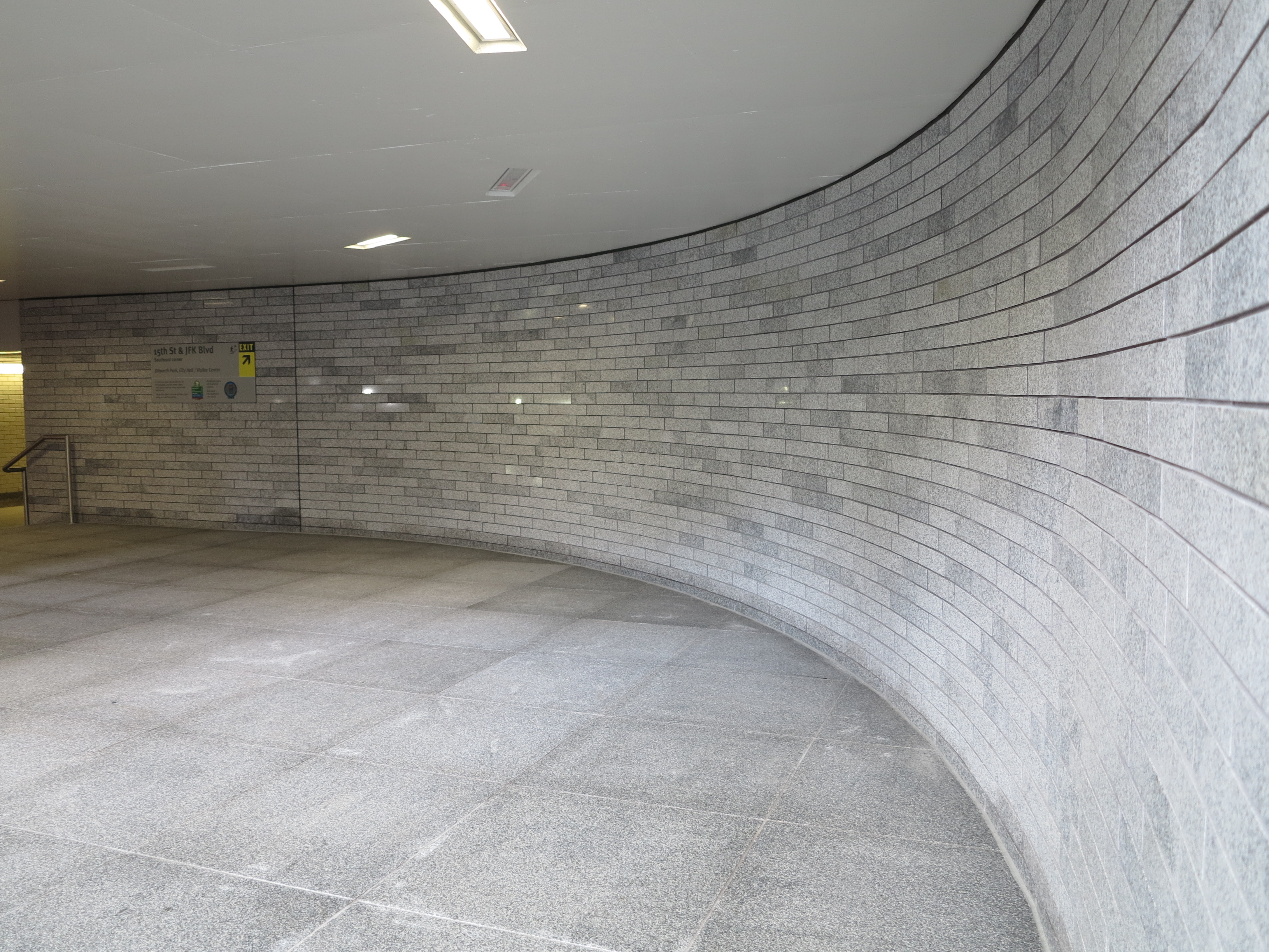 Polished granite walls, made of stone recycled from the old Dilworth Plaza