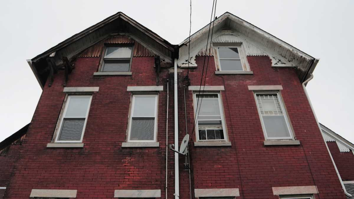 The twin homes at 145-147 Sumac St. are described as rare examples of Eastlake Victorian architecture. (Bas Slabbers/for NewsWorks)