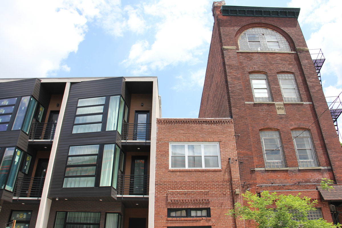 At Third and Green streets in Northern Liberties, new homes abut old. | Emma Lee/WHYY