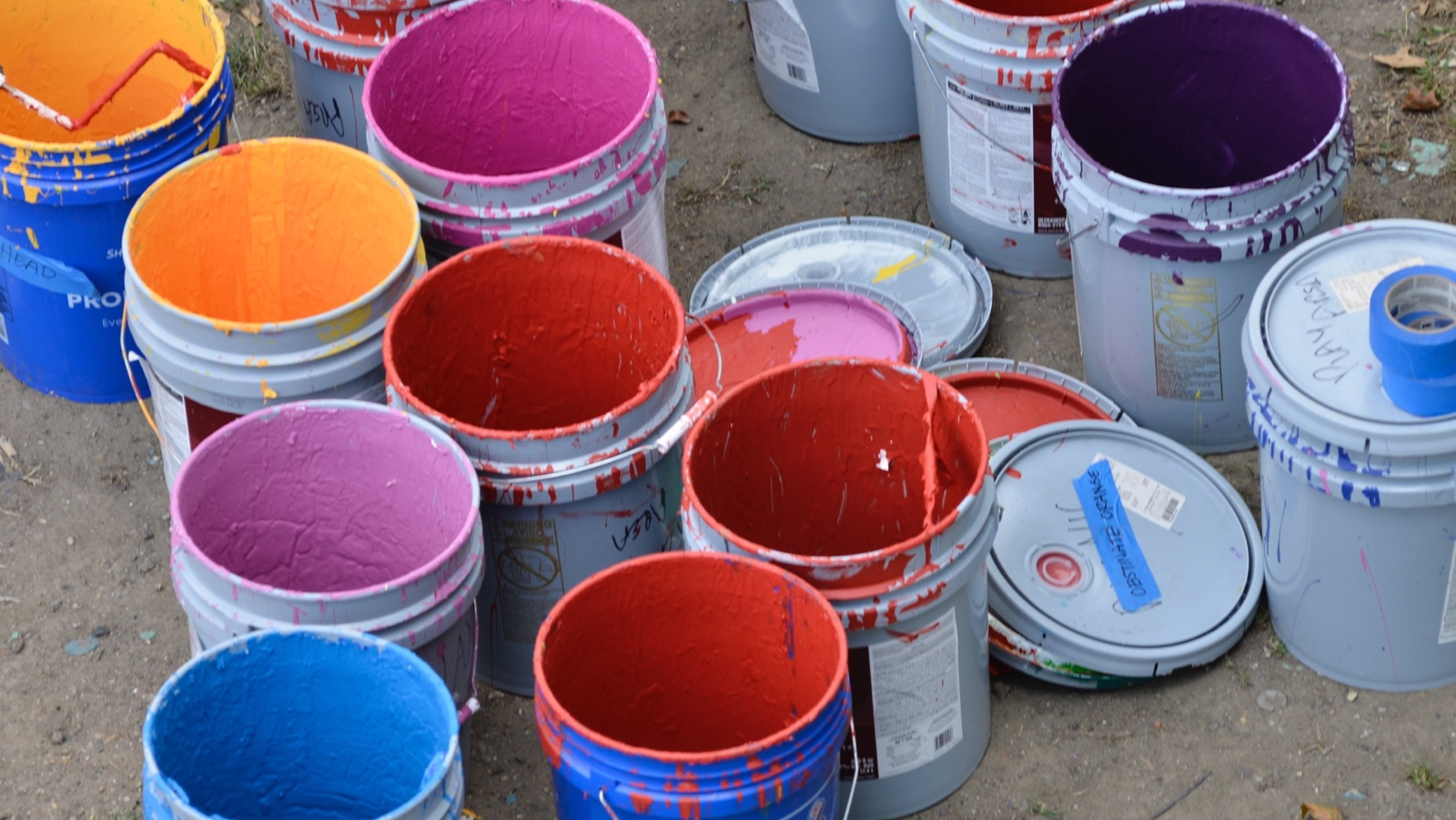Buckets of paint used for  painting 'Rhythm & Hues' at Eakins Oval. (Bastiaan Slabbers for NewsWorks)