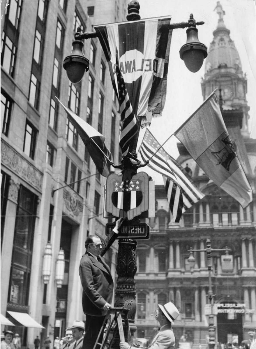 City officials decorate a lamp post for the 1936 Democratic National Convention. | Special Collections Research Center, Temple University Library, Philadelphia PA