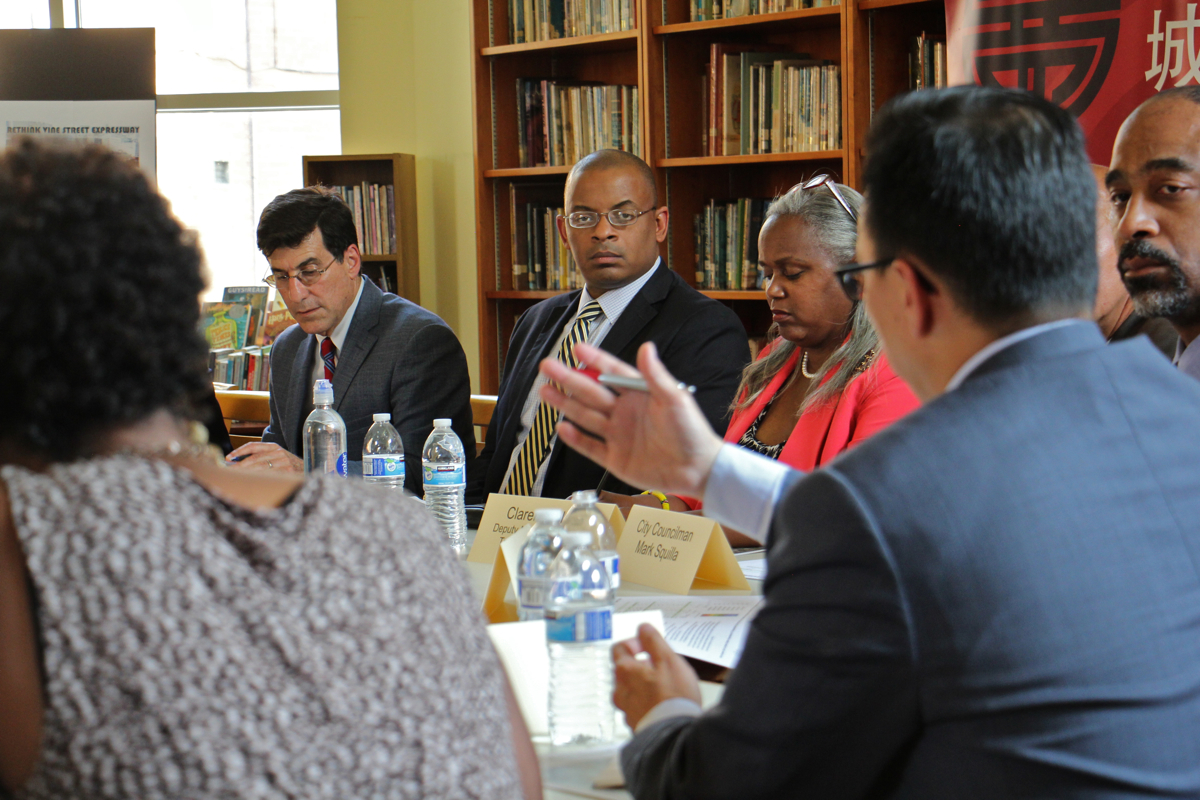 U.S. Transportation Secretary Anthony Foxx (center)  listens to John Chin, director of the Philadelphia Chinatown Development Corporation, during a roundtable discussion at Holy Redeemer Chinese Catholic School. (Emma Lee/WHYY)