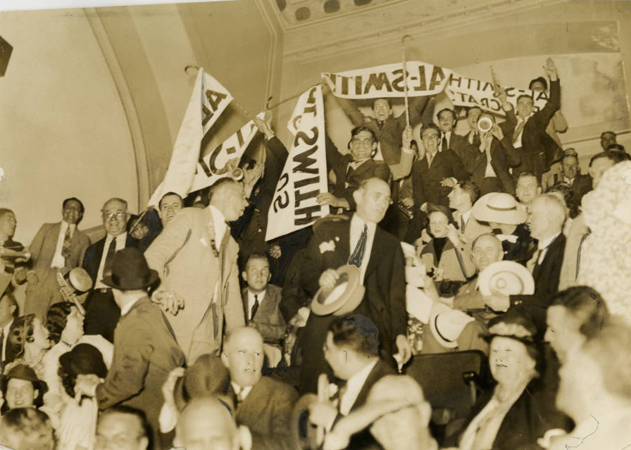 A chaotic crowd of Al Smith supporters displayed signs that read Al Smith is a Real Democrat. The crowd broke out into fists fights and were forcibly removed after ten minutes from the Democratic National Convention. Philadelphia, June 26, 1936| Evening Bulletin | Special Collections Research Center, Temple University Libraries, Philadelphia, PA