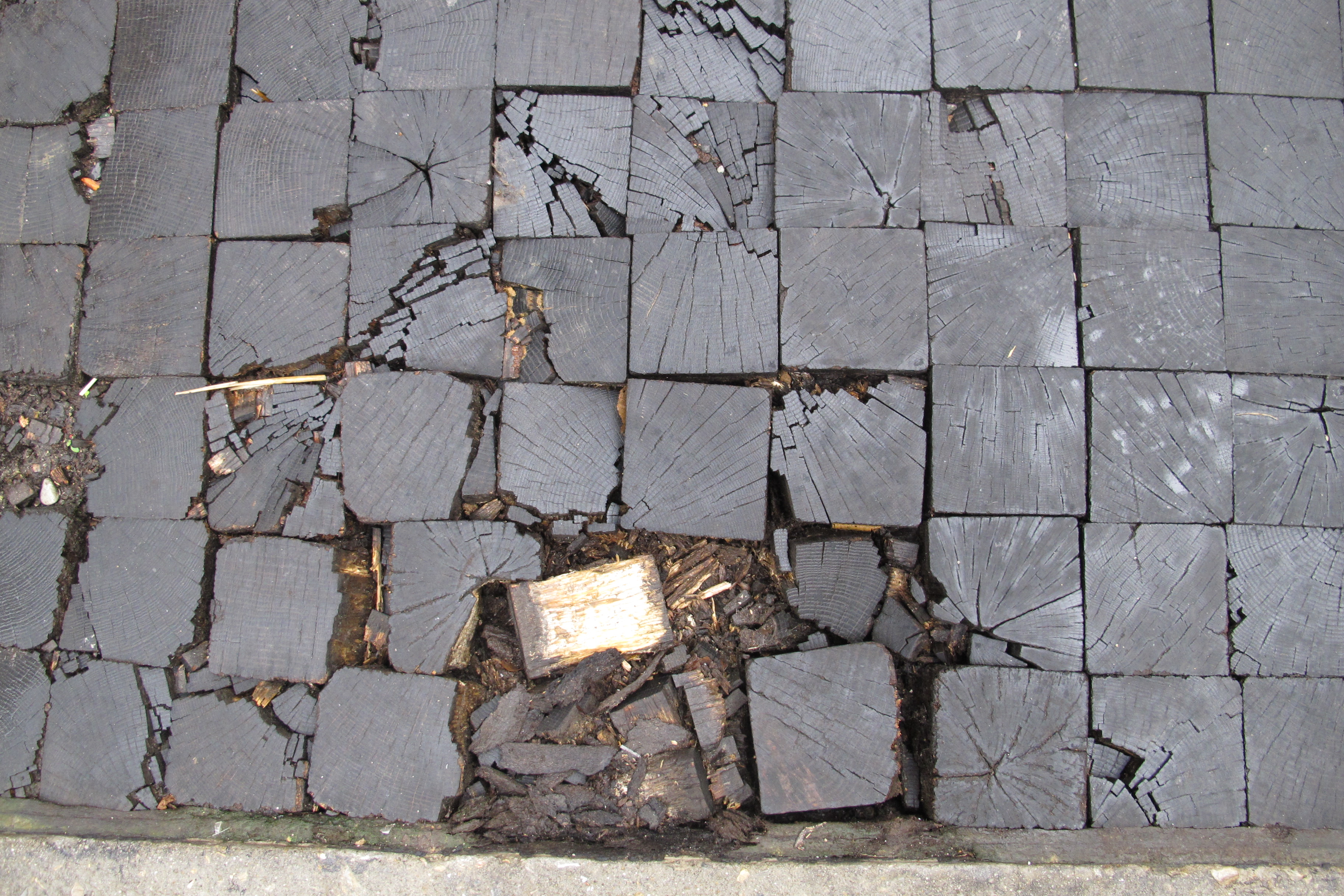 Camac Street's oak block pavers were getting chewed up. (October 9, 2012)