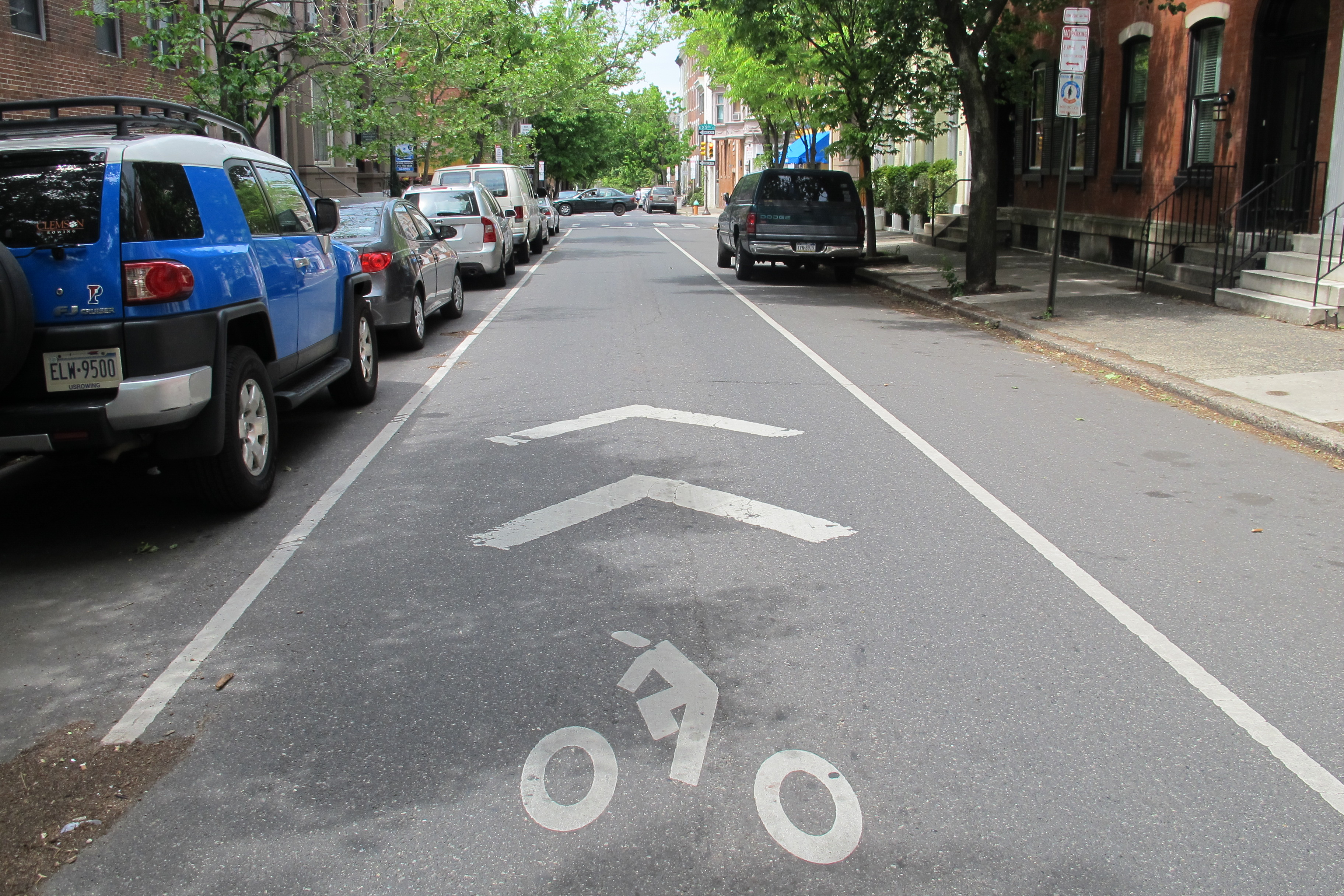 Sharrows , like this one on Spruce Street, are meant to direct bicycle traffic and instruct drivers and cyclists to share the road.