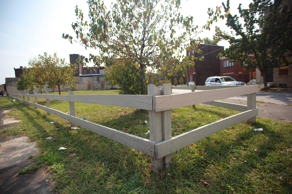 Vacant lots that are maintained by PHS feature an open wood fence with openings narrow enough to prevent unwanted dumping.