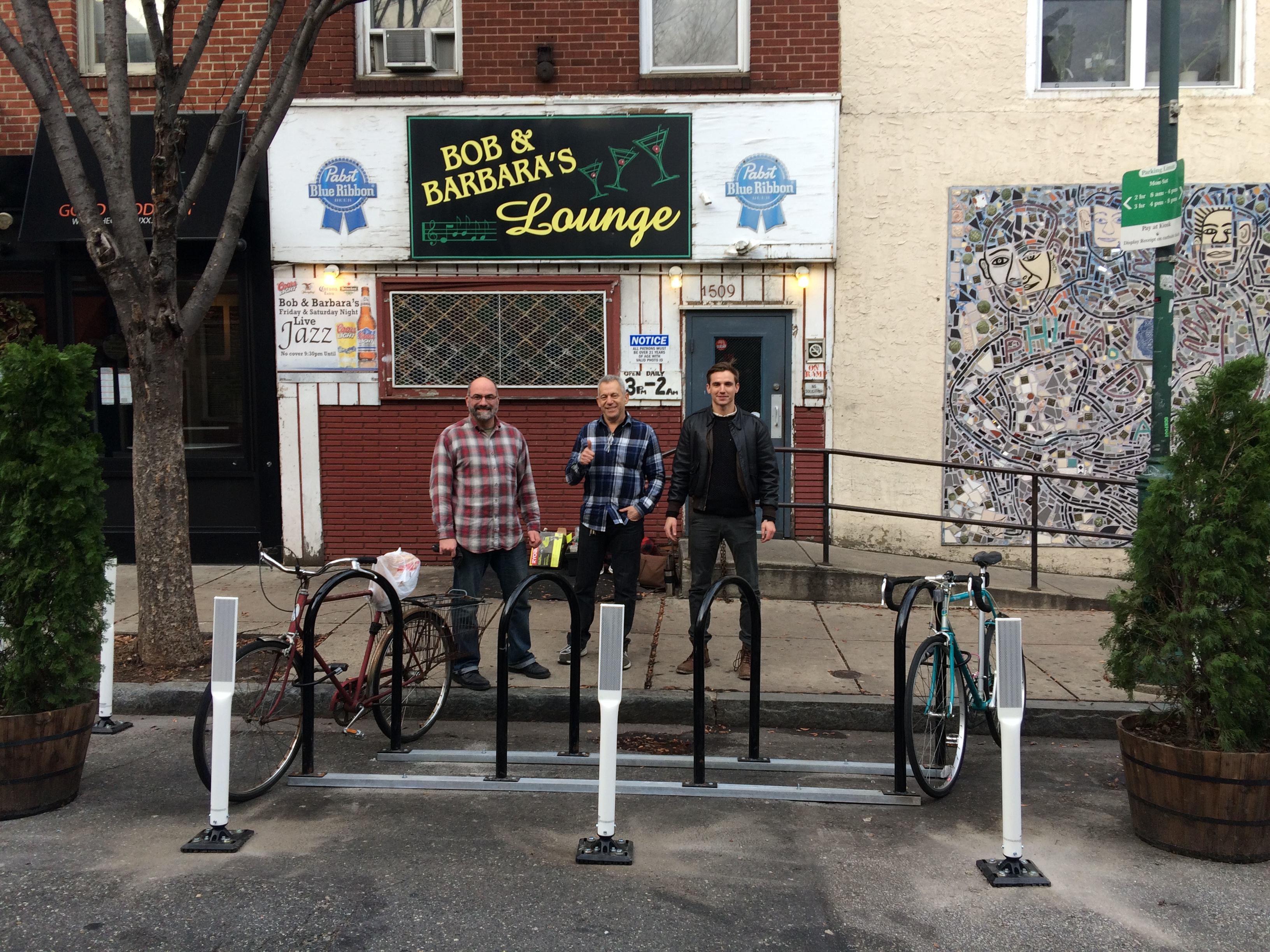 Install team poses with newly installed bike corral in front of Bob & Barbara's (from L to R): Marcus Ferreria, Jack Prince, Steve Cobb