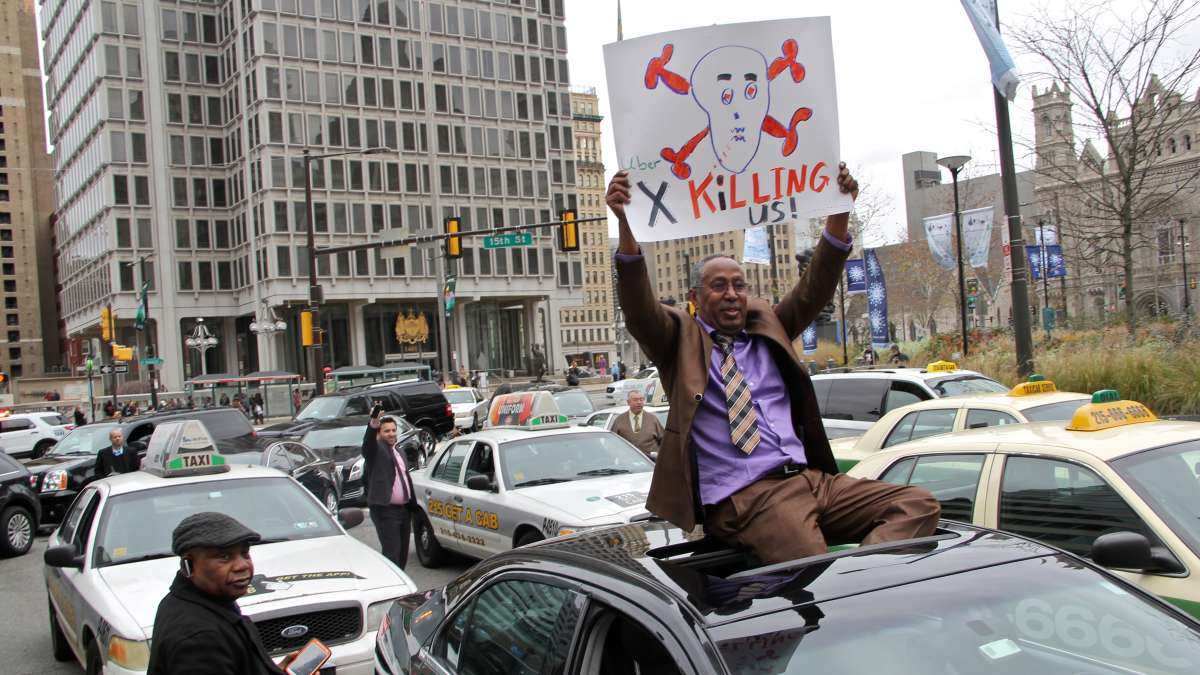 Limo driver Isam Ahmed protesting ride share competition, December 2015 | Emma Lee/WHYY
