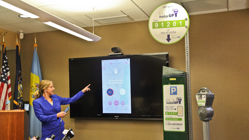 PPA project manager Sue Cornell explains meterUP app at a press conference