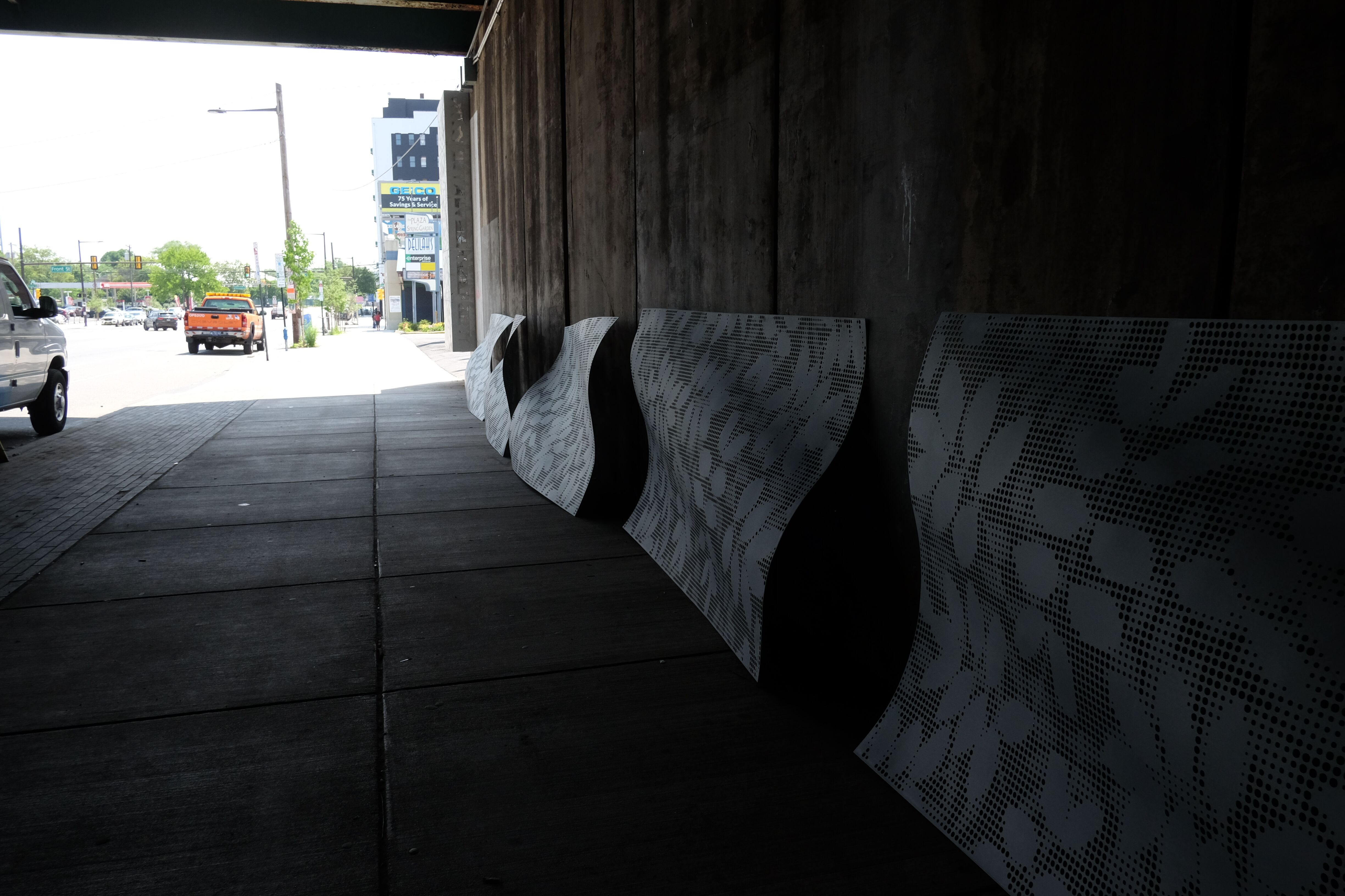 Spring Garden Connector: Panels suspended from the underpass roof wave.