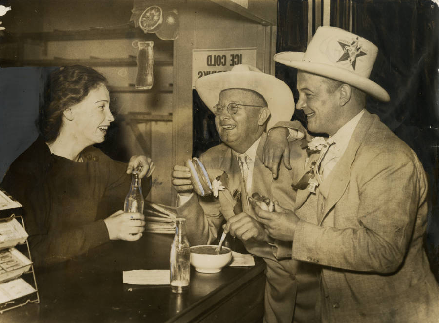 Beatrice Zippel,of 1932 South Third Street, serves lunch to Earle B. Mayfield Jr., and State Senator Thomas G. Pollard, of Texas. | Philadelphia, June 25, 1936 | Evening Bulletin | Special Collections Research Center, Temple University Libraries, Philadelphia, PA