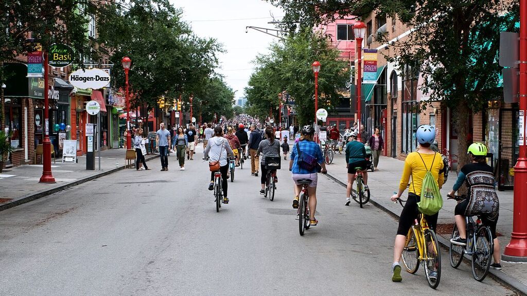 Throngs of cyclists and pedestrians taking advantage of a carless Saturday on South Street during the inaugural Philly Free Streets (Bas Slabbers/For WHYY)