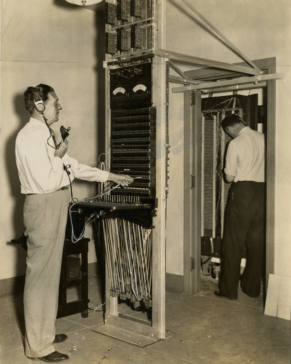 Installing a transformer board inside the Convention Hall for press workrooms to communicate with newspapers during the Democratic convention. | Evening Bulletin | Special Collections Research Center, Temple University Libraries, Philadelphia, PA