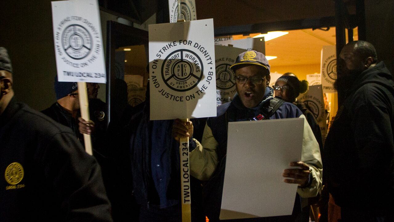 TWU Local 234 workers rallied at their union hall on Oct. 28 and distributed strike signs for the picket lines (Brad Larrison for WHYY)