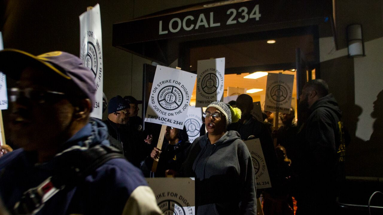 TWU Local 234 workers rally Friday night and distribute strike signs for the picket lines (Brad Larrison for WHYY)