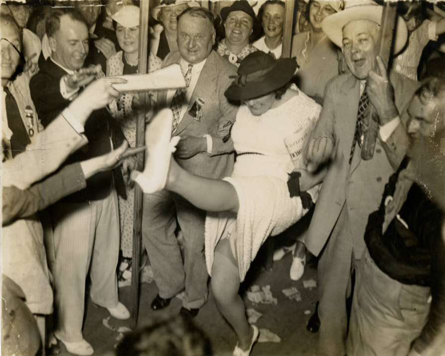 Woman trying to kick off her own hat for Roosevelt at Democratic Convention, Philadelphia 1936. | Evening Bulletin | Special Collections Research Center, Temple University Libraries, Philadelphia, PA