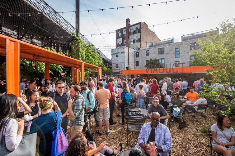 A popup beer garden created on a lot beneath the Reading Viaduct for Philadelphia's Rail Park in 2016. (Hood Studio)