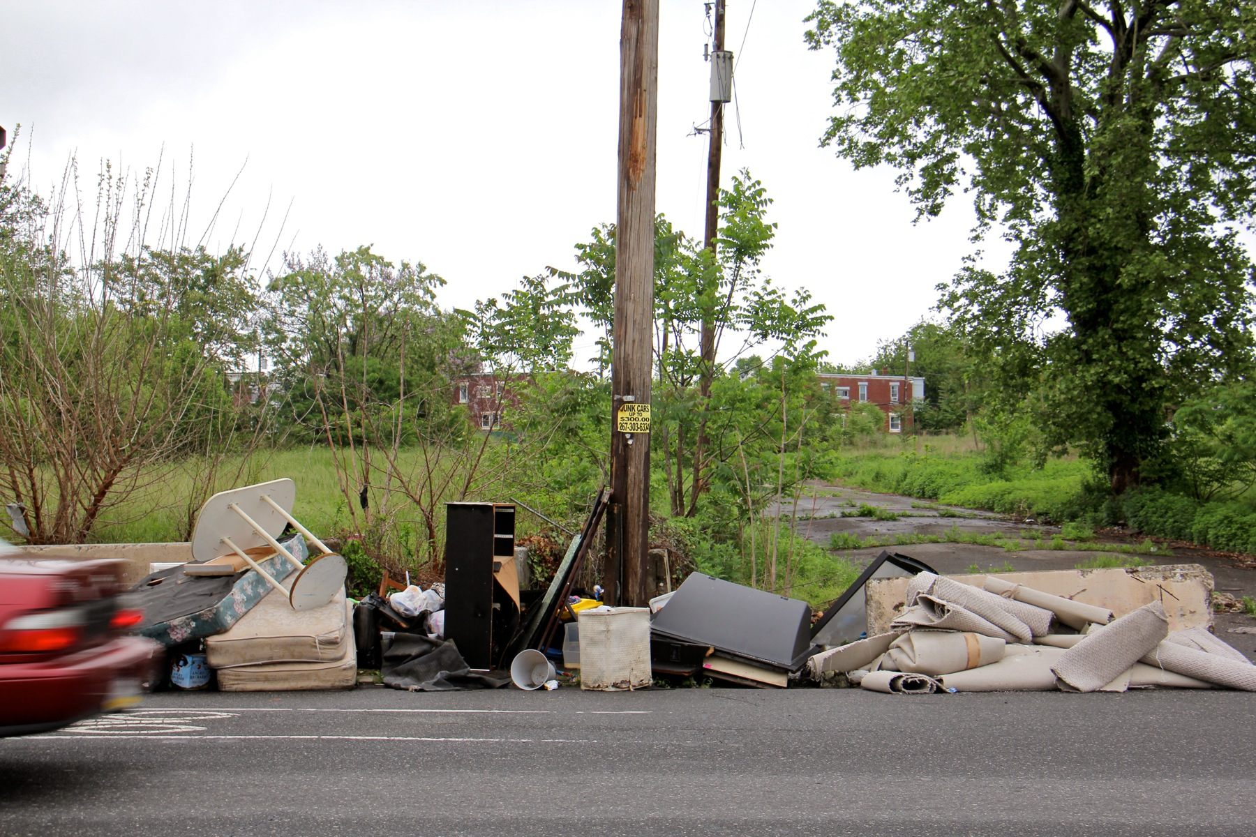 A virtual household's worth of trash illegally dumped at the Logan Triangle.