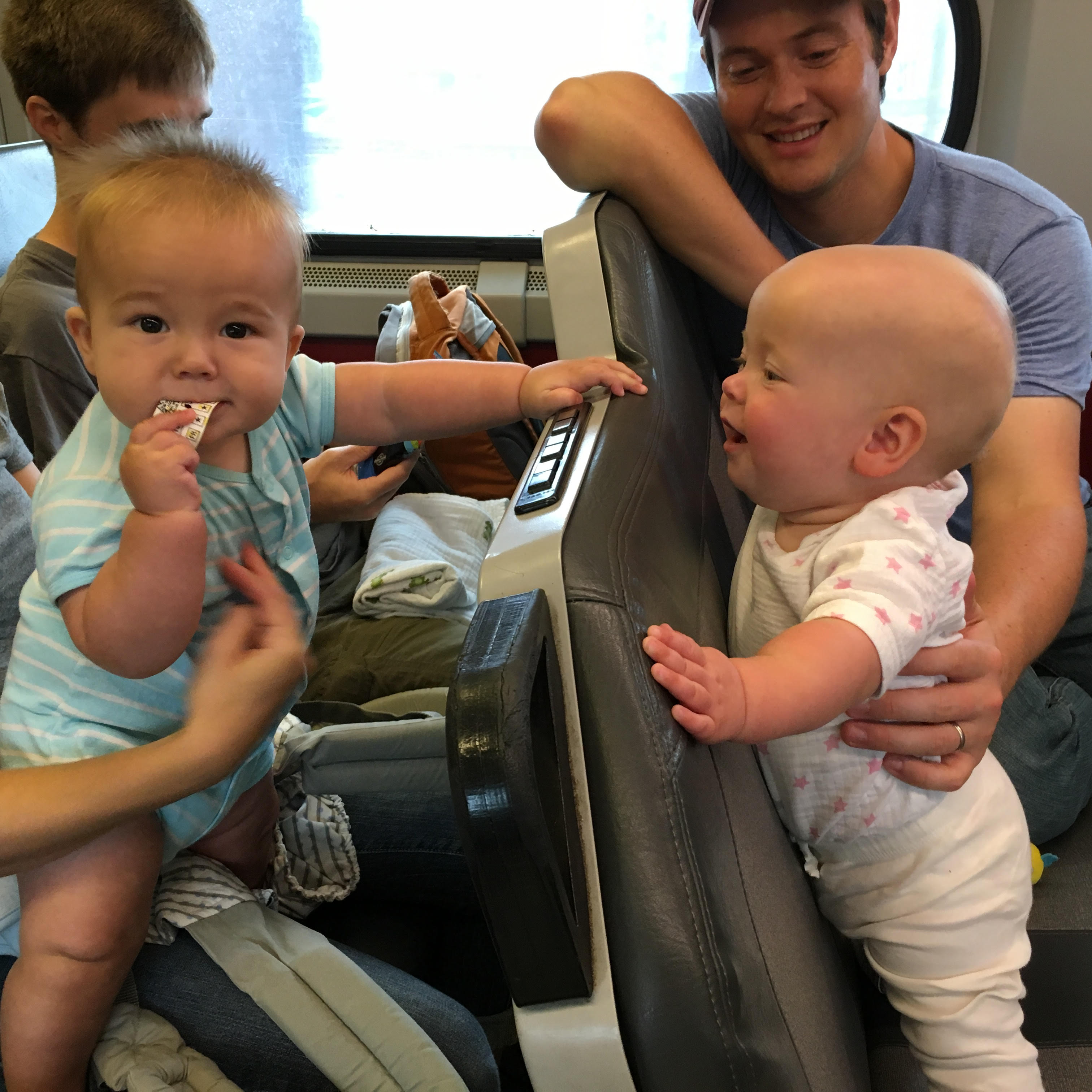 Ally Jane and Erik ride on regional rail. | courtesy of the Johansons